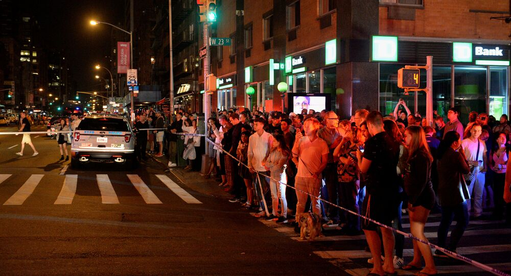 Onlookers stand behind a police cordon near the site of an explosion in the Chelsea neighborhood of Manhattan, New York, U.S. September 17, 2016.