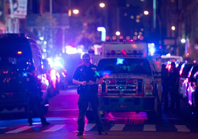 Police and first responders work near the site of a bomb explosion on West 23rd Street on September 17, 2016, in New York