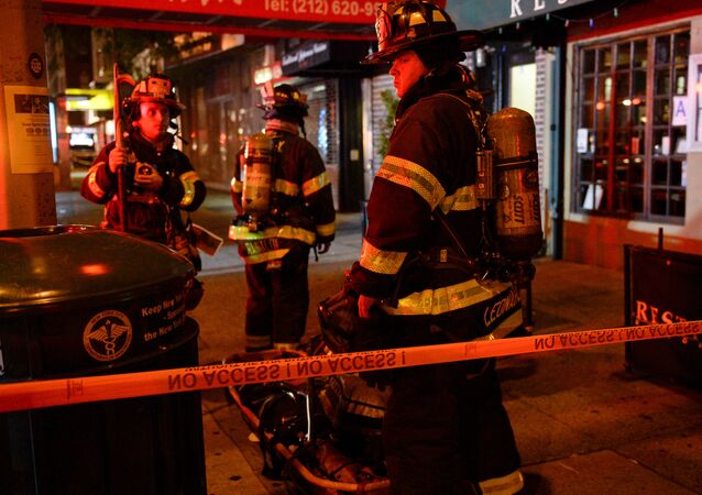 New York City firefighters stand near the site of an explosion in the Chelsea neighborhood of Manhattan, New York, U.S. September 18, 2016.
