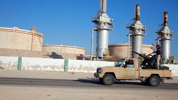 Libyan forces loyal to eastern commander Khalifa Haftar ride a pickup truck at the Zueitina oil terminal in Zueitina, west of Benghazi, Libya. file photo  - Sputnik International