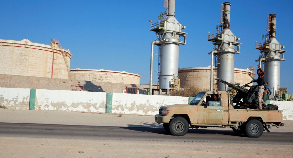 Libyan forces loyal to eastern commander Khalifa Haftar ride a pickup truck at the Zueitina oil terminal in Zueitina, west of Benghazi, Libya. fiel photo