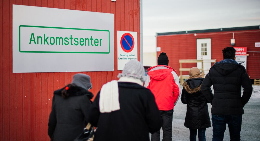 Refugees enter the arrival centre for refugees near the town on Kirkenes, northern Norway