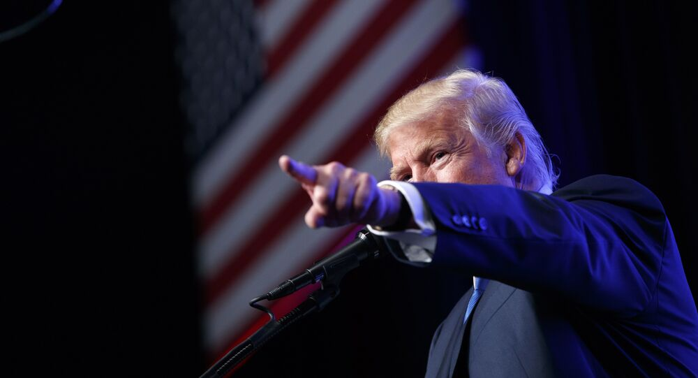 In this Sept. 16, 2016, photo, Republican presidential candidate Donald Trump speaks during a campaign rally at the James L. Knight Center in Miami.