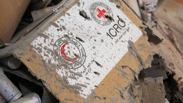 Damaged Red Cross and Red Crescent medical supplies lie inside a warehouse after an airstrike on the rebel held Urm al-Kubra town, western Aleppo city, Syria September 20, 2016. - Sputnik International