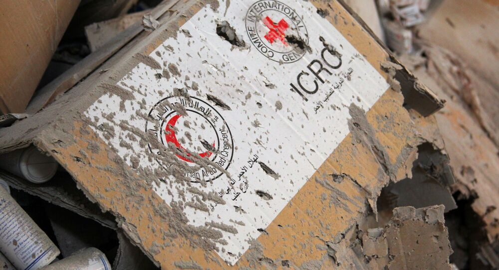 Damaged Red Cross and Red Crescent medical supplies lie inside a warehouse after an airstrike on the rebel held Urm al-Kubra town, western Aleppo city, Syria September 20, 2016.