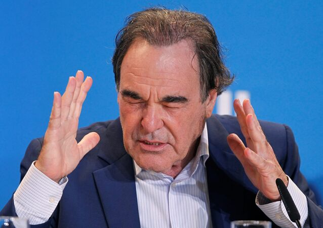 Director Oliver Stone attends a press conference to promote the film Snowden at TIFF, the Toronto International Film Festival, in Toronto.