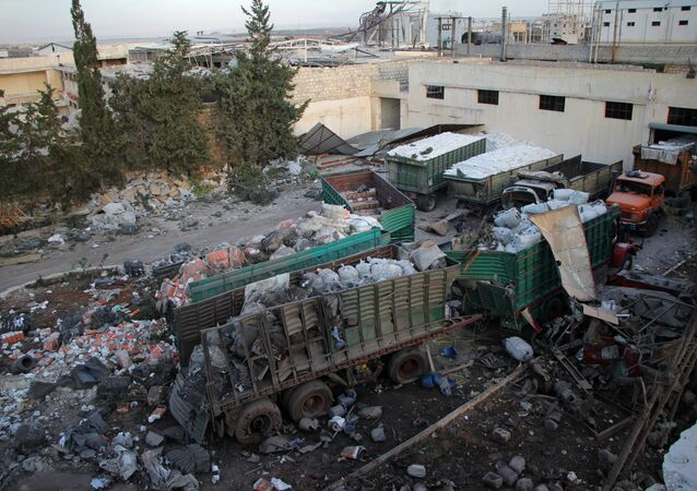 Aid is seen strewn across the floor in the town of Orum al-Kubra on the western outskirts of the northern Syrian city of Aleppo on September 20, 2016, the morning after a convoy delivering aid was hit by a deadly air strike.