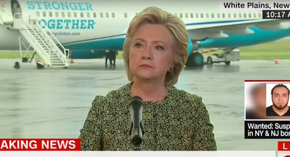 Clinton listens to a question from Bloomberg reporter Jennifer Epstein.