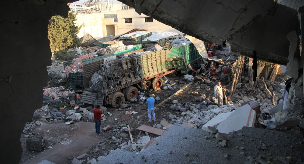 Aid is seen strewn across the floor in the town of Orum al-Kubra on the western outskirts of the northern Syrian city of Aleppo on September 20, 2016, the morning after a convoy delivering aid was hit by a deadly air strike