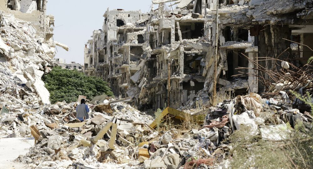 A general view shows destroyed buildings in the government-held Jouret al-Shiah neighbourhood of the central Syrian city of Homs on September 19, 2016