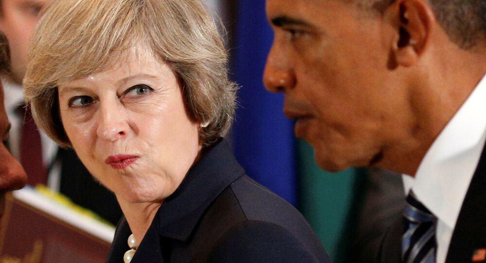 British Prime Minister Theresa May looks over toward U.S. President Barack Obama during the luncheon at the United Nations General Assembly in New York September 20, 2016.