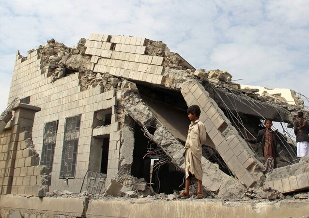 People stand on the rubble of a school destroyed by a Saudi-led air strike in an outskirt of the northwestern city of Saada, Yemen September 14, 2016