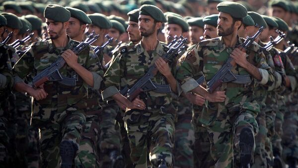 Members of Iran's Revolutionary Guards march during a military parade to commemorate the 1980-88 Iran-Iraq war in Tehran. - Sputnik International