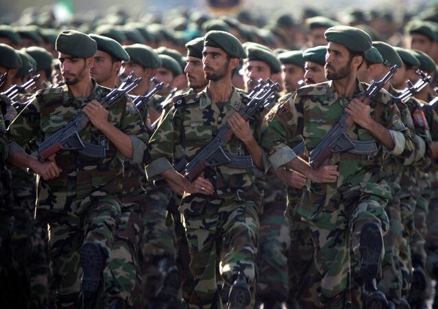 Members of Iran's Revolutionary Guards march during a military parade to commemorate the 1980-88 Iran-Iraq war in Tehran. File photo