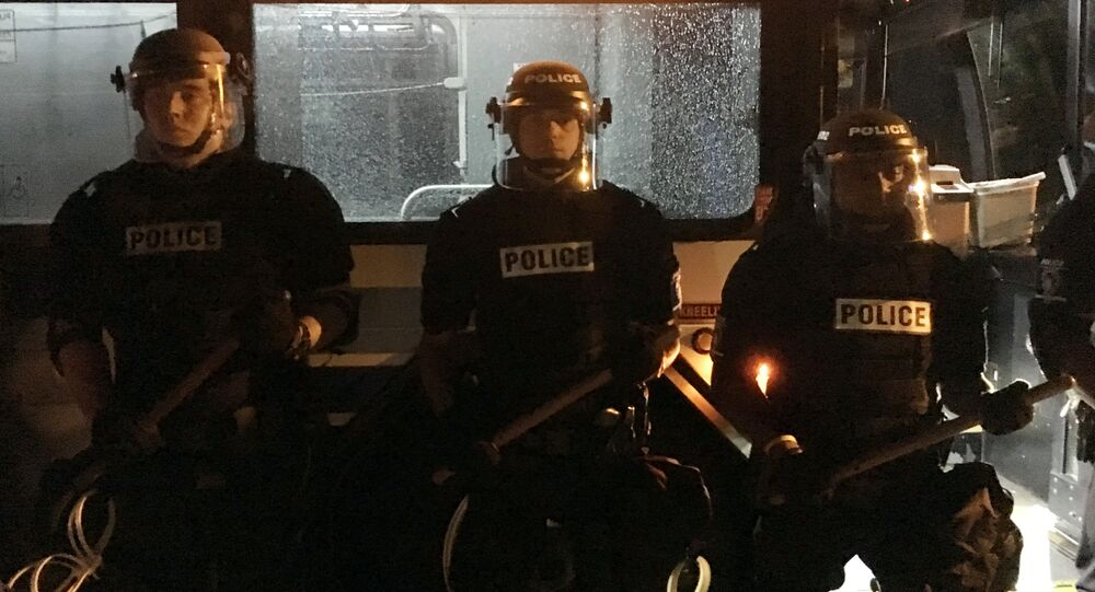 Cops Stand In Front Of A Bus In Charlotte During Keith Lamont Scott Protests