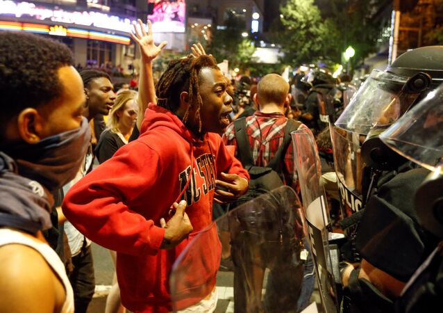 A man speaks to police in uptown Charlotte, NC during a protest of the police shooting of Keith Scott, in Charlotte, North Carolina, U.S. September 21, 2016