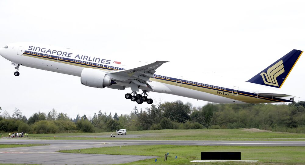 A Singapore Airlines Boeing 777-312ER takes off from Paine Field in Everett, Wash. File photo