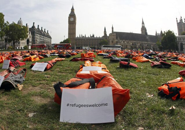 A display of lifejackets worn by refugees during their crossing from Turkey to the Greek island of Chois, are seen Parliament Square in central London, Britain September 19, 2016