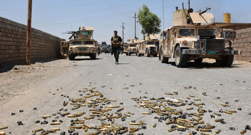 Shell casings lie on the ground as Iraqi government forces gather around the Qayyarah airbase, which was seized by Iraqi forces last week from jihadists of the Islamic State (IS)group, on July 13, 2016, some 60 kilometres (35 miles) south of Mosul