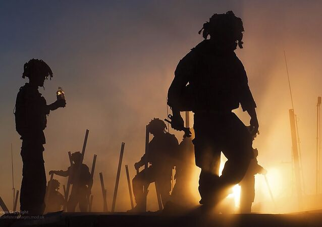 Soldiers dismantling patrol base in Afghanistan