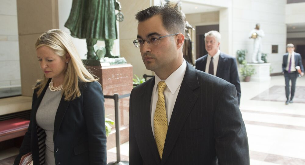 Bryan Pagliano (R), a former State Department employee who worked on former US Secretary of State and Democratic Presidential hopeful Hillary Clinton's private e-mail server, leaves after invoking his Fifth Amendment right against self-incrimination, before the House Select Committee on Benghazi, on Capitol Hill in Washington, DC, September 10, 2015
