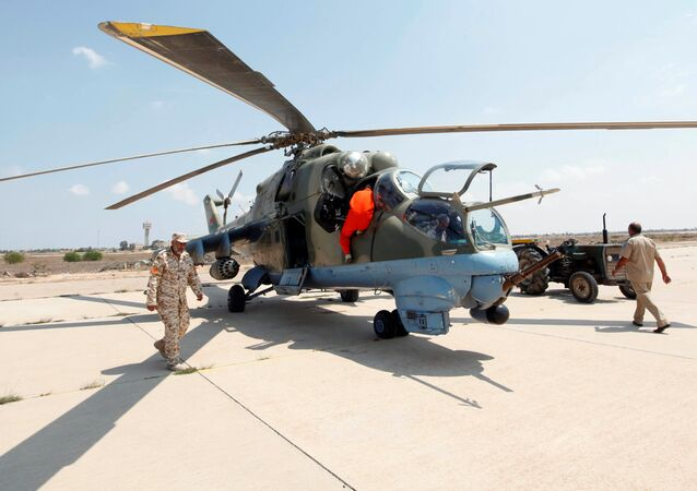 Members of Libyan forces allied with the UN-backed government prepare a renovated Libyan helicopter at Misurata air base, Libya September 4, 2016