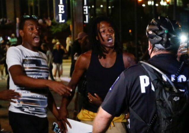 People shout at the police in uptown Charlotte, NC during a protest of the police shooting of Keith Scott, in Charlotte, North Carolina, U.S. September 21, 2016