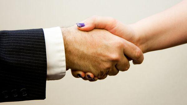 Handshake man - women - Sputnik International