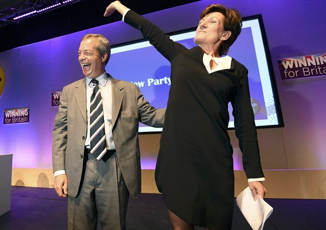 Nigel Farage (L), the outgoing leader of the United Kingdom Independence Party (UKIP), congratulates new leader Diane James, at the party's annual conference in Bournemouth, Britain, September 16, 2016.