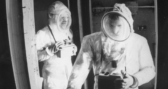 Technicians wearing protective suits conduct decontamination of the Chernobyl Nuclear Plant.