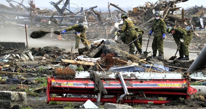 Japan's Self-Defense Force soldiers remove debris left by the March 11 tsunami in the city of Minamisoma in Fukushima prefecture on May 2, 2011.