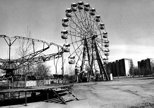 A picture dated 26 April 1996 for the 10th anniversary of the Chernobyl disaster, showing the ghost city of Pripyat. This attractions park has been once local children's favourite place of rest.