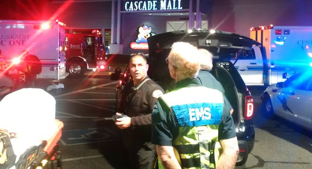 Medics wait to gain access to the Cascade Mall after four people were shot dead in Burlington, Washington, U.S. September 24, 2016.