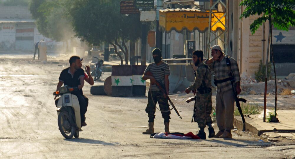 Terrorists from the Jund al-Aqsa group man a checkpoint in Taybat al Imam town after they advanced in the town in Hama province, Syria August 31, 2016
