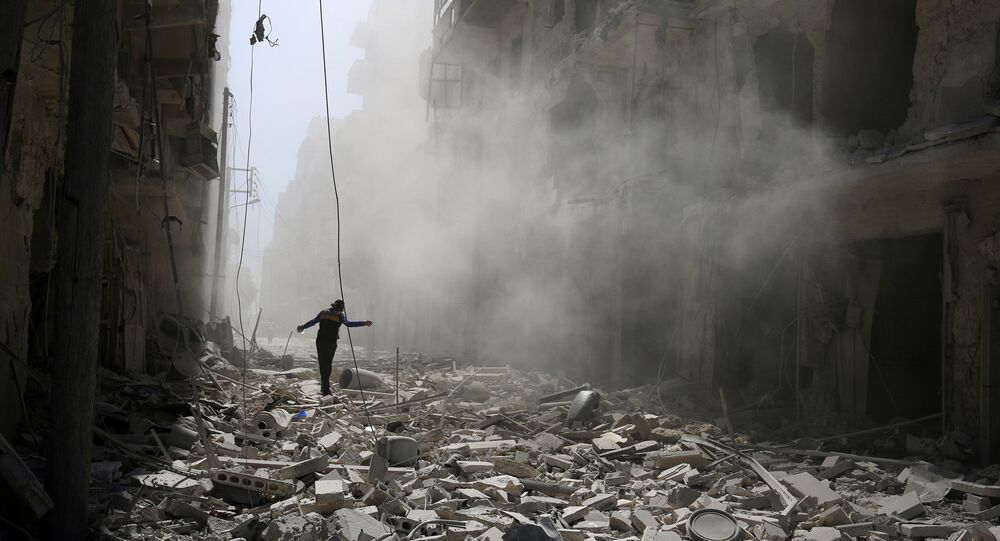 A man walks on the rubble of damaged buildings in Aleppo, Syria September 25, 2016