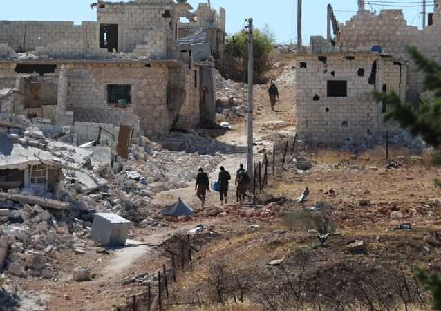 Syrian government forces walk amidst debris in the largely deserted Palestinian refugee camp of Handarat, north of Aleppo. (File)