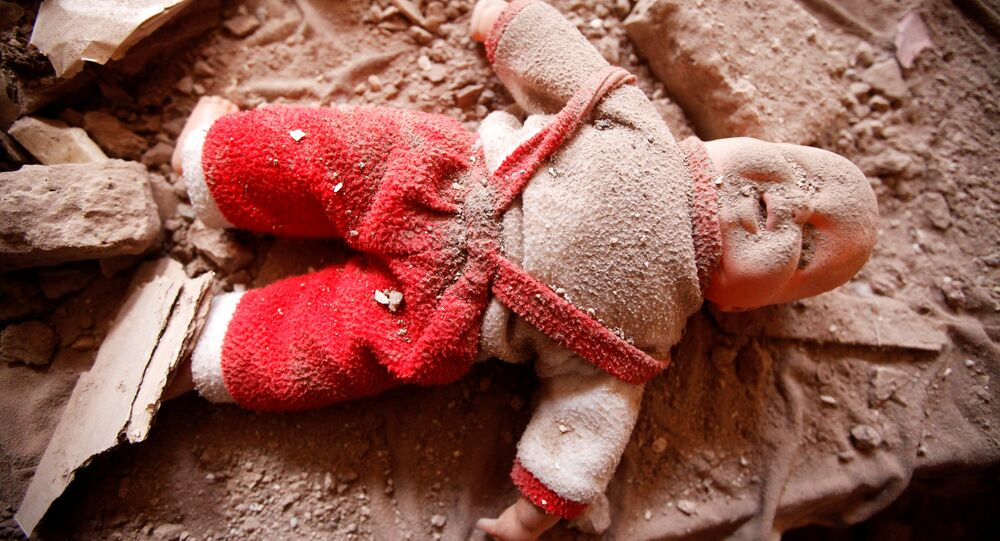 A doll is seen on a bed in a damaged house destroyed during a Saudi-led air strike in old Sanaa city, Yemen, September 24, 2016.
