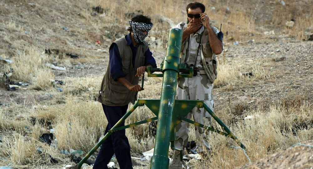 Rebel fighters prepare to launch homemade mortar rounds at Syrian army forces on in the northern Syrian city of Raqqa.