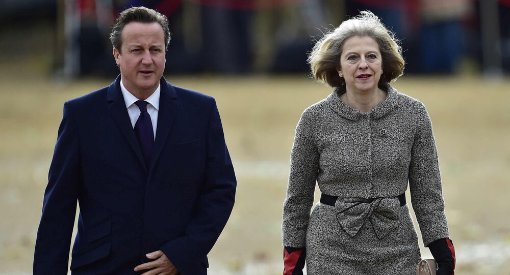 Former Britain's Prime Minister David Cameron (L) and current British Prime Minister Theresa May (R)