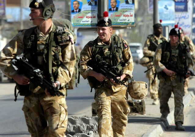British soldiers patrol a street in the southern city of Basra, 11 December 2005.