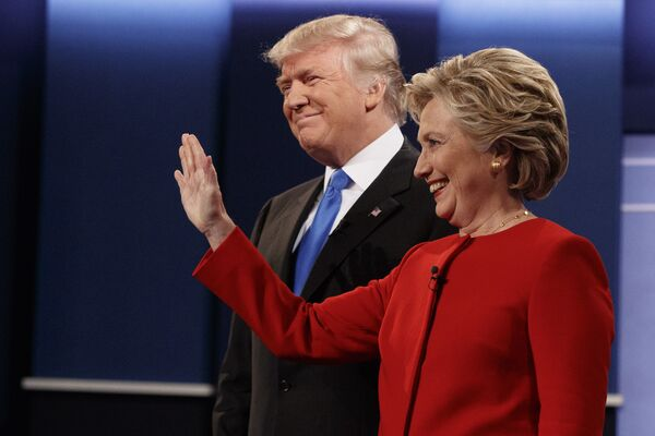 Republican presidential candidate Donald Trump, left, stands with Democratic presidential candidate Hillary Clinton before the first presidential debate at Hofstra University, Monday, Sept. 26, 2016, in Hempstead, N.Y. - Sputnik International