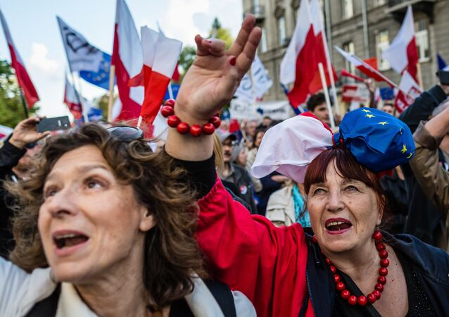 People attend the anti-government demonstration of the Committee for the Defence of Democracy movement (KOD) in Warsaw, Poland on September 24, 2016.