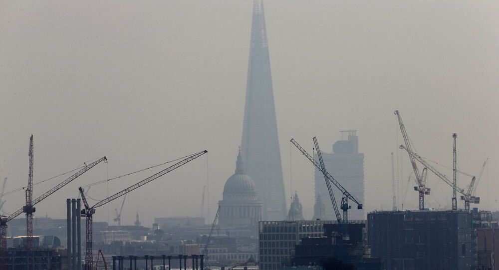 Smog surrounds The Shard and St Paul's Cathedral in London, Britain, April 3, 2014.