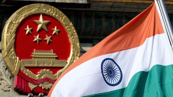 An Indian national flag is flown next to the Chinese national emblem. (File) - Sputnik International
