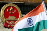 An Indian national flag is flown next to the Chinese national emblem. (File)