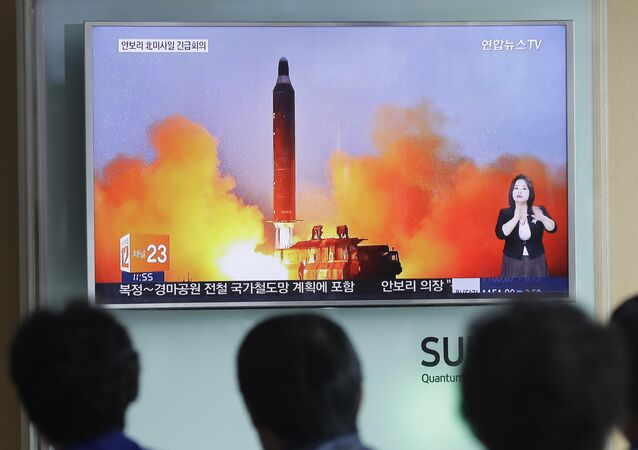People watch a TV news channel airing an image of North Korea's ballistic missile launch published in North Korea's Rodong Sinmun newspaper at the Seoul Railway Station in Seoul. (File)