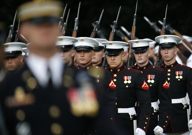 Members of the U.S Marine Corps honor guard march on to the South Lawn of the White House