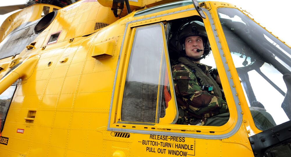 Britain's Prince William is pictured at the controls of a Sea King helicopter during a training exercise at Holyhead Mountain, having flown from RAF Valley in Anglesey, north Wales, on March 31, 2011
