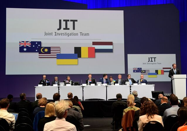 Members of a joint investigation team present the preliminary results of the criminal investigation into the downing of Malaysia Airlines flight MH17, in Nieuwegein