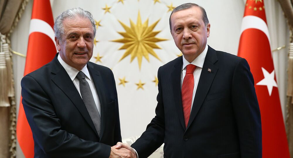Turkish President Recep Tayyip Erdogan, right, and European Commissioner for Migration Dimitris Avramopoulos shake hands before a meeting in Ankara, Turkey, Monday, April 4, 2016.